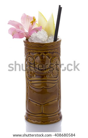 Tropical cocktail served in a tiki style glass and garnished with fruits isolated on white background - stock photo