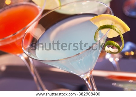 Tropical cocktails in martini glass on tray - stock photo