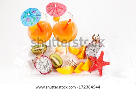 Tropical cocktails with fresh exotic fruits, on the table - stock photo