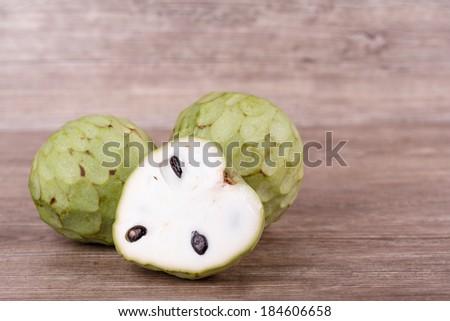 Tropical custard apple fruit on wooden background - stock photo