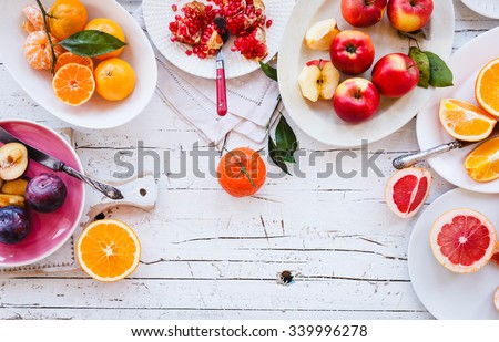 Tropical detox smoothie and snacking fruit bowl. New breakfast trend. Pastel rustic still life. - stock photo