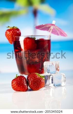Tropical drink on beach and sun  - stock photo