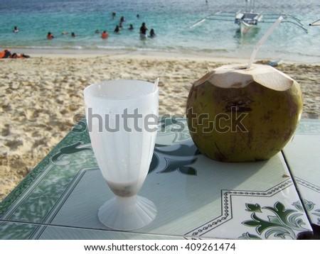 Tropical drinks on the beach - stock photo