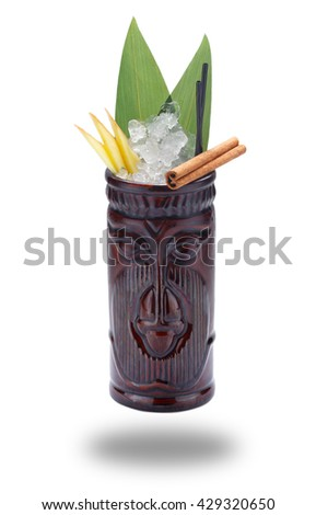 Tropical drinks served on tiki mugs isolated on shite background with shadow - stock photo