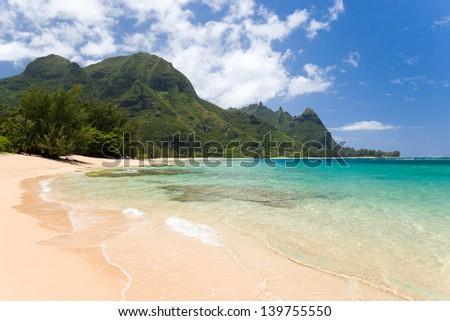 tropical exotic secluded beach in haena kauai hawaii - stock photo