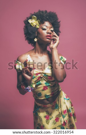 Tropical Fashion Afro American Pin-up Holding Ice cream. Against Pink Background.
