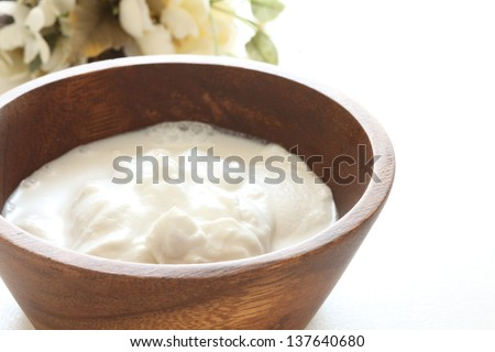 tropical food ingredient, coconut milk in wooden bow with copy space