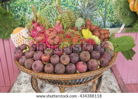 Tropical Fruit in the basket /selective focus - stock photo