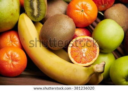 Tropical fruit on black wooden background, top view. Selective focus. - stock photo