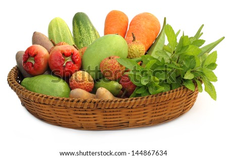 Tropical fruits and vegetables on a basket
