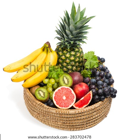 Tropical fruits in a basket isolated on white background - stock photo