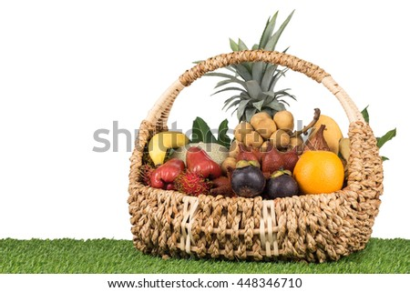 Tropical fruits inside basket that good for healthy with oraganic food.
