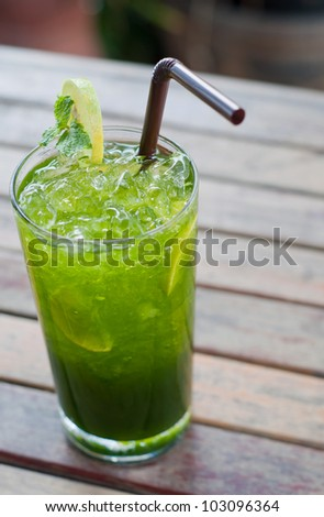 tropical green cocktail with lemon and fresh mint - stock photo