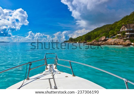 Tropical island and boat on Seychelles - vacation background - stock photo
