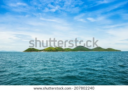 Tropical island and speed boat going to island - stock photo