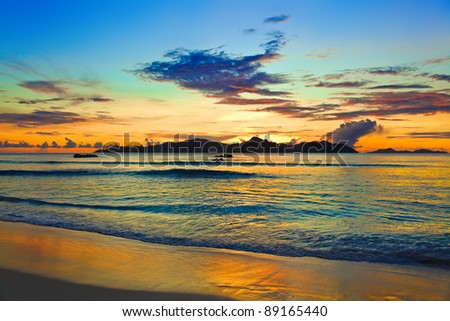 Tropical island at sunset - nature background - stock photo