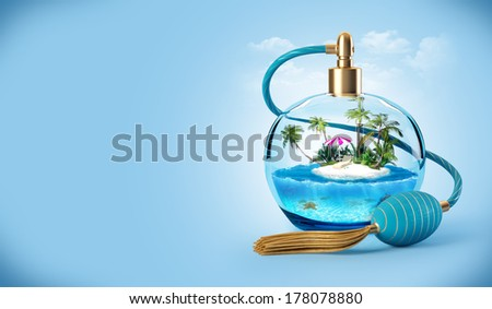 Tropical island in a perfume bottle. Traveling background - stock photo