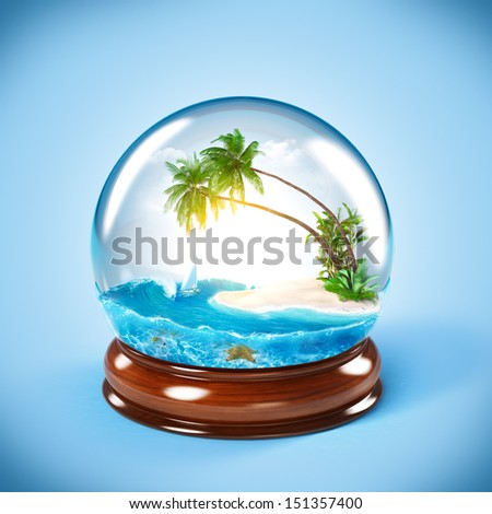 tropical island in the glass globe. Traveling, vacation - stock photo