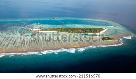 Tropical island of Maldives, with small wooden houses on Sea - stock photo