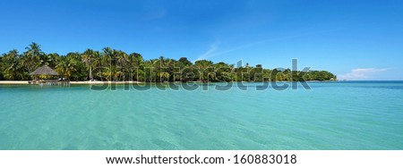 Tropical island panoramic with calm sea and blue sky, Caribbean, Panama - stock photo