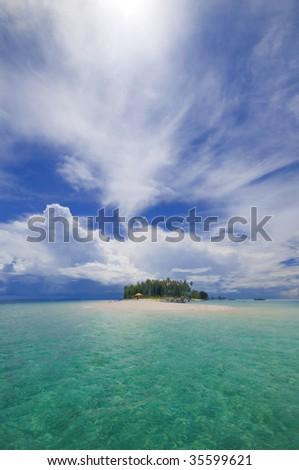 Tropical island with white sandy beach. - stock photo