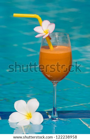 Tropical juice at the swimming pool - stock photo