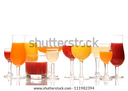 Tropical juices in glasses isolated on white - stock photo