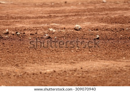 Tropical laterite soil or red earth background - stock photo
