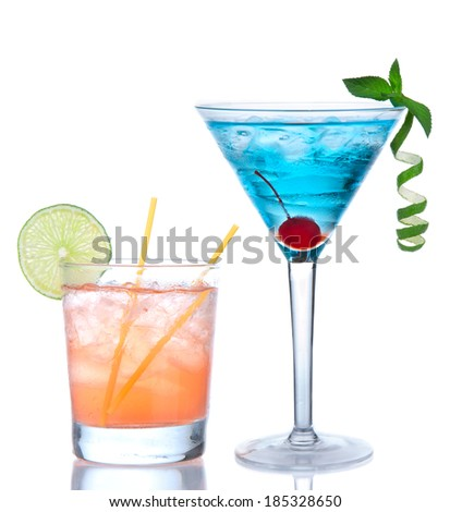 Tropical Martini cosmopolitan cocktail blue hawaiian and yellow margarita alcohol drink isolated on a white background - stock photo