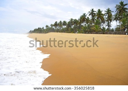 Tropical ocean Grand Bassam beach in Cote d'Ivoire, stock photo. - stock photo