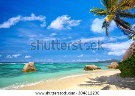 Tropical palm beach in La Digue Island, Seychelles - stock photo