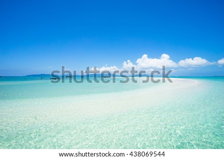 Tropical paradise beach and clear water of a coral reef lagoon, Okinawa, Japan - stock photo