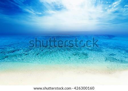 Tropical paradise beach / Sea blue sky sand sun daylight relaxation landscape for design postcard or calendar - stock photo
