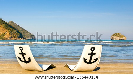 Tropical Paradise. Panorama of tropical white sand beach with sun beds - stock photo
