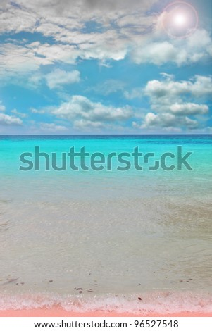 Tropical paradise scene with dramatic sky, clear waters and a touch of pink sand - stock photo