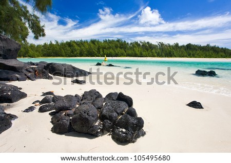Tropical paradise, White sand beach, turquoise ocean and blue sky, Mauritius - stock photo