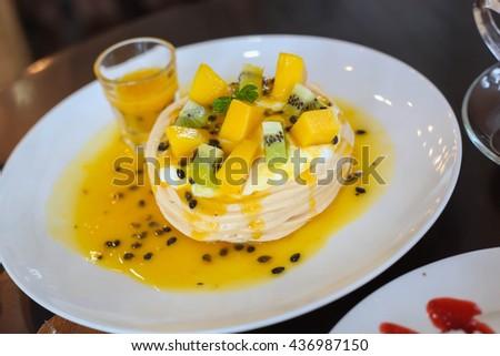 tropical pavlova, passionfruit dessert - stock photo