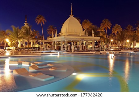 Tropical pool at night, Aruba, Caribbean - stock photo