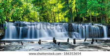 Tropical rainforest landscape with flowing blue water of Kulen waterfall in Cambodia - stock photo