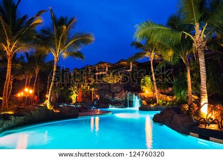 Tropical Resort Pool at Sunset in Hawaii - stock photo