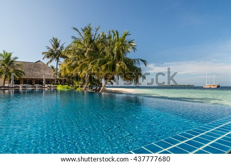 Tropical resort poolside with sea background
