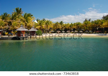 Tropical resort with turquoise lagoon and palms on Mauritius - stock photo