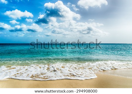 Tropical Sand beach and wave - stock photo