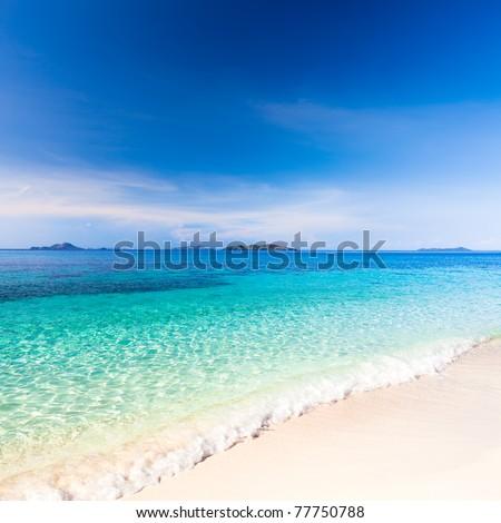 Tropical sandy beach Malcapuya at summer sunny day - stock photo
