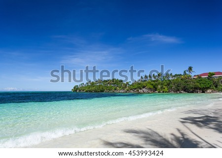 Tropical sandy seashore with turquoise water - stock photo