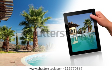 Tropical Scene with swimming pool and tablet pc