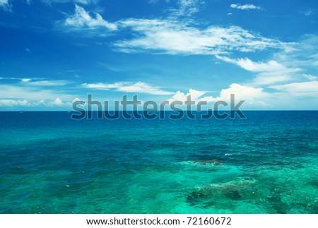 Tropical sea and blue sky. - stock photo