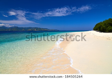 tropical sea and sky with clouds, Gili Meno, Lombok, Indonesia - stock photo