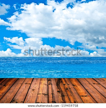 Tropical sea and wooden floor background - stock photo