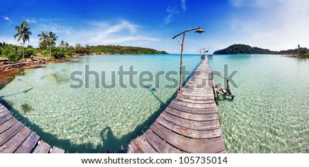 Tropical sea panorama with pier on small island - stock photo
